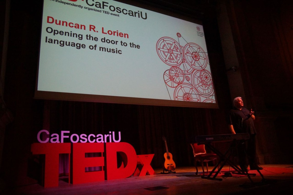 "Duncan delivering the talk ""Opening the door to the language of music"" at the TEDx lectures in Italy"